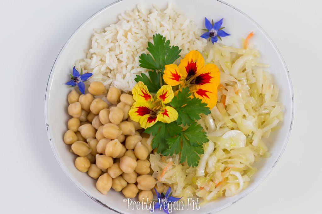 Health benefits of eating vegan - sauerkraut rice and edible flowers dinner